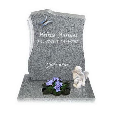 Gravstein med blomster, sommerfugl og en liten engel statue. På gravsteinen står det 'Helene Austnes. 13-12-1948. 4-1-2017. Guds nåde.'